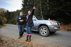 Allison Stuart points out a bald eagle (Haliaeetus leucocephalus) to Maggie Martin (left) along the Chilkoot River near Haines, Alaska. Stuart and Martin were part of a class team conducting a weekly count of bald eagles during the fall as part of a citizen science project class at the Haines School. Behind the car are Ella Bredthauer, Haines Middle School science teacher and Meredith Pochardt, Takshanuk Watershed Council project manager. The project is part of a field-based for-credit class, sponsored by the Takshanuk Watershed Council, in which students participate in research studies and learn about field data collection. Under the guidance of Pam Randles, Takshanuk Watershed Council Education Director, students count bald eagles in the Chilkat River Valley using spotting scopes at 10 locations and present their data at the Bald Eagle Festival held in November in Haines. During late fall, bald eagles congregate along the Chilkat River to feed on salmon. This gathering of bald eagles in the Alaska Chilkat Bald Eagle Preserve is believed to be one of the largest gatherings of bald eagles in the world.