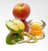 Apples and Honey, Symbols of Roah Hashanah the Jewish New Year on white background