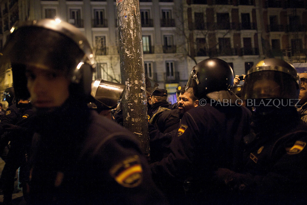 Riot police arrest a protesters during a demonstration against corruption and to claim Mariano Rajoy to resign, in Madrid on January 31, 2013. The Spanish Newspaper 'El Pais' published secret papers of income implicating Spanish Prime Minister and other members of the PP (Popular Party). Rajoy's government has denied these secret payments.