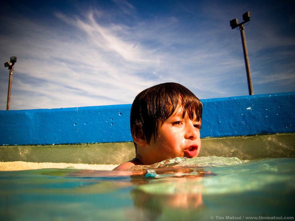 THIS PHOTO IS AVAILABLE EXCLUSIVELY FROM AURORA PHOTOS; LICENSING MUST GO THROUGH AURORA.<br /> Visit Aurora and Keyword &quot;Tim Matsui&quot; <br /> http://www.auroraphotos.com / +1.207.828.8787<br /> <br /> Young boy swims.