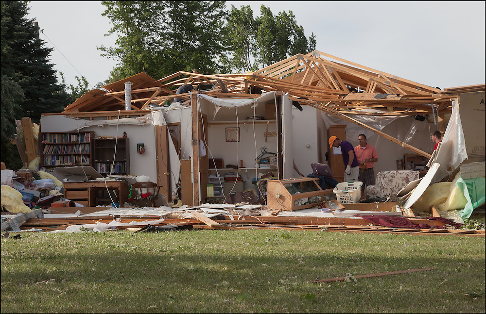 An entire wall exposing every room of a house making it look like a dollhouse following an EF-2 tornado that went through Watkins, Minnesota.