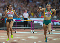 Athletics - 2017 IAAF London World Athletics Championships - Day Nine, Evening Session<br /> <br /> Womens 100m Hurdle Final<br /> <br /> Sally Pearson (Australia) crosses the line as Pamela Dutkiewicz (Germany) Looks on at the London Stadium<br /> <br /> COLORSPORT/DANIEL BEARHAM