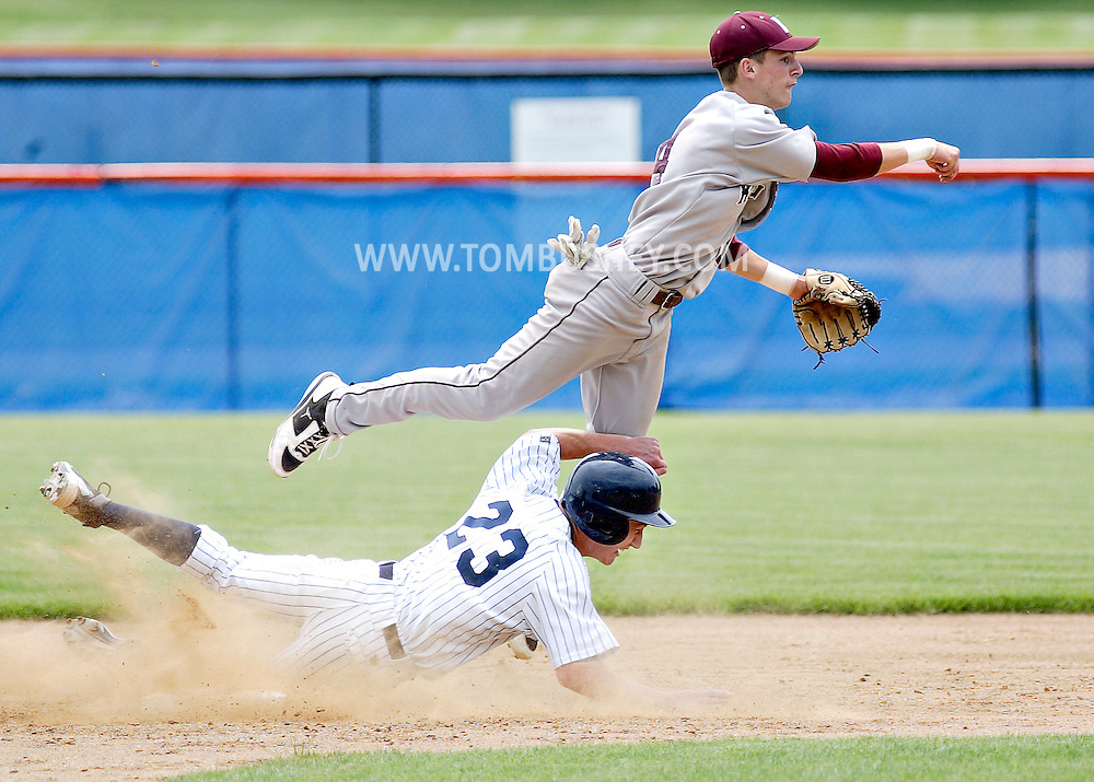 Kingston shortstop Zach Short throws to first after forcing  Pine Bush baserunner Andrew Overton (23) at second base during the Section 9 Class AA baseball championship game at SUNY New Paltz on Friday June 1, 2012.