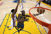 January 31, 2019; Oakland, CA, USA; Golden State Warriors forward Draymond Green (23) shoots the basketball against Philadelphia 76ers center Joel Embiid (21) during the first half at Oracle Arena.