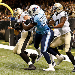 Aug 15, 2014; New Orleans, LA, USA; New Orleans Saints tight end Jimmy Graham (80) catches a touchdown past Tennessee Titans strong safety Bernard Pollard (31) during first quarter of a preseason game at Mercedes-Benz Superdome. Mandatory Credit: Derick E. Hingle-USA TODAY Sports
