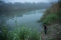 A border patrol agent looks across the Rio Grande river, in Hidalgo, TX, on the U.S.-Mexico border, on February 2, 2017 (Photo/Scott Dalton)