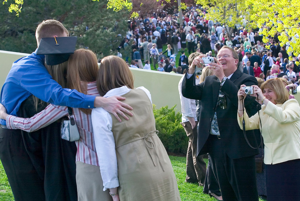 Jeff and Sylvia Hessing of Boise, Idaho take a photo of their daughter Amy and other family members after Amy graduated from BYU commencement at the Marriott Center In Provo, UtahThursday April 21 2005. August Miller/ Deseret Morning News DIGITAL PHOTOGRAPH