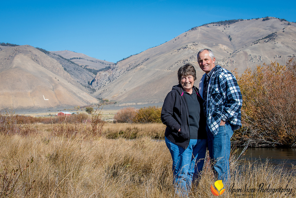 Ranchers Merrill and Sharal Beyeler stand on the banks of the Lemhi River in Leadore, Idaho.
