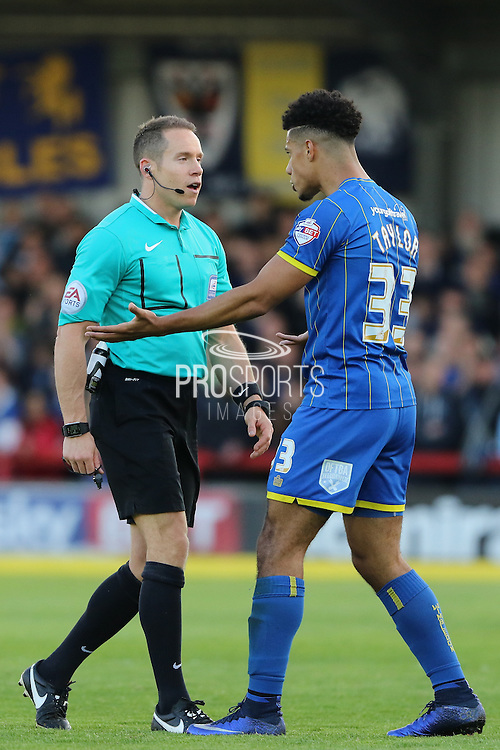 Lyle Taylor forward for AFC Wimbledon (33) remonstrates with the referee during the Sky Bet League 2 Play-Off first leg match between AFC Wimbledon and Accrington Stanley at the Cherry Red Records Stadium, Kingston, England on 14 May 2016. Photo by Stuart Butcher.