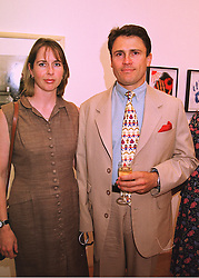 MR & MRS CHRIS MOON, he worked with the late Diana, Princess of Wales to make people aware of the suffering Landmines cause, at an exhibition in London on 20th May 1998.MHT 9