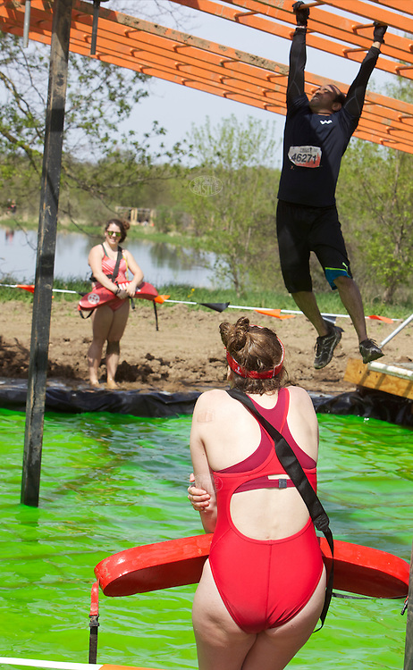 Coverage of Tough Mudder competition, Chicago, at the Richmond Hunting Club, Genoa,  Illinois, May 10, 2014. Photo credit Tom Wagner-no usage allowed without written permission from photographer, ©2014 Tom Wagner, all rights reserved.