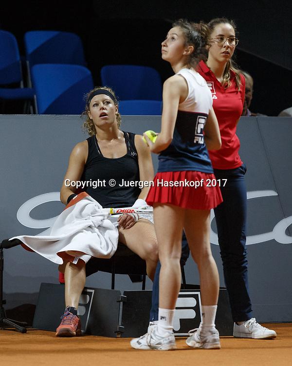 LAURA SIEGEMUND (GER)  sitzt auf einem Stuhl und wartet auf die Fortsetzung des Spiels waehrend der Platz von Konfetti gesaeubert wird.<br /> <br /> Tennis - Porsche  Tennis Grand Prix 2017 -  WTA -  Porsche-Arena - Stuttgart -  - Germany  - 25 April 2017.