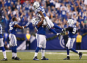 INDIANAPOLIS, IN - DECEMBER 20:  Zach Kerr #94 of the Indianapolis Colts holds up Mike Adams #29 after recovering a fumble during the first quarter against the Houston Texans at Lucas Oil Stadium on December 20, 2015 in Indianapolis, Indiana.  (Photo by Michael Hickey/Getty Images) *** Local Caption *** Zach Kerr;Mike Adams