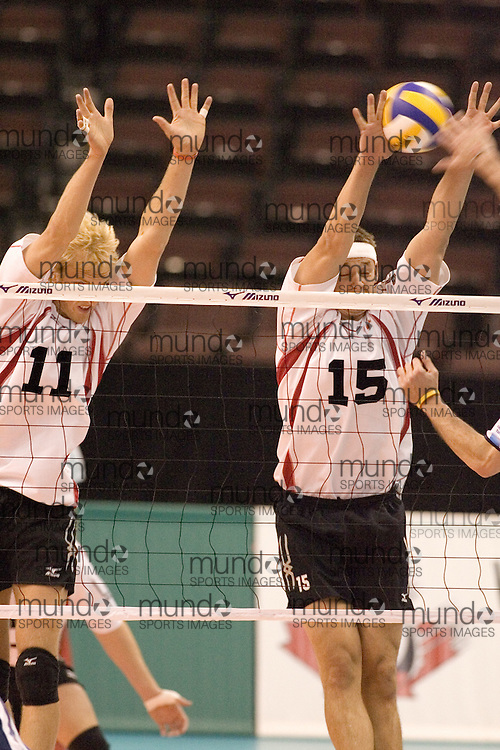 Steve Brinkman (11) and Fred Winters (15) of  Canada during a three games to none defeat of Argentina in the 2006 Anton Furlani Volleyball Cup, held in Ottawa, Canada. .Anton Furlani Cup.Copyright Sean Burges / Mundo Sport Images, 2006