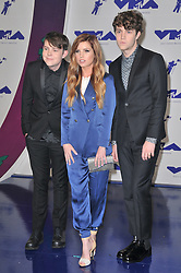 (L-R) Graham Sierota, Sydney Sierota and Noah Sierota of musical group Echosmith at the 2017 MTV Video Music Awards held at The Forum on August 27, 2017 in Inglewood, CA, USA (Photo by Sthanlee B. Mirador/Sipa USA)