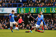 Portsmouth's Oli Hawkins tackles Peterborough's Idris Kanu during the EFL Sky Bet League 1 match between Portsmouth and Peterborough United at Fratton Park, Portsmouth, England on 7 December 2019.