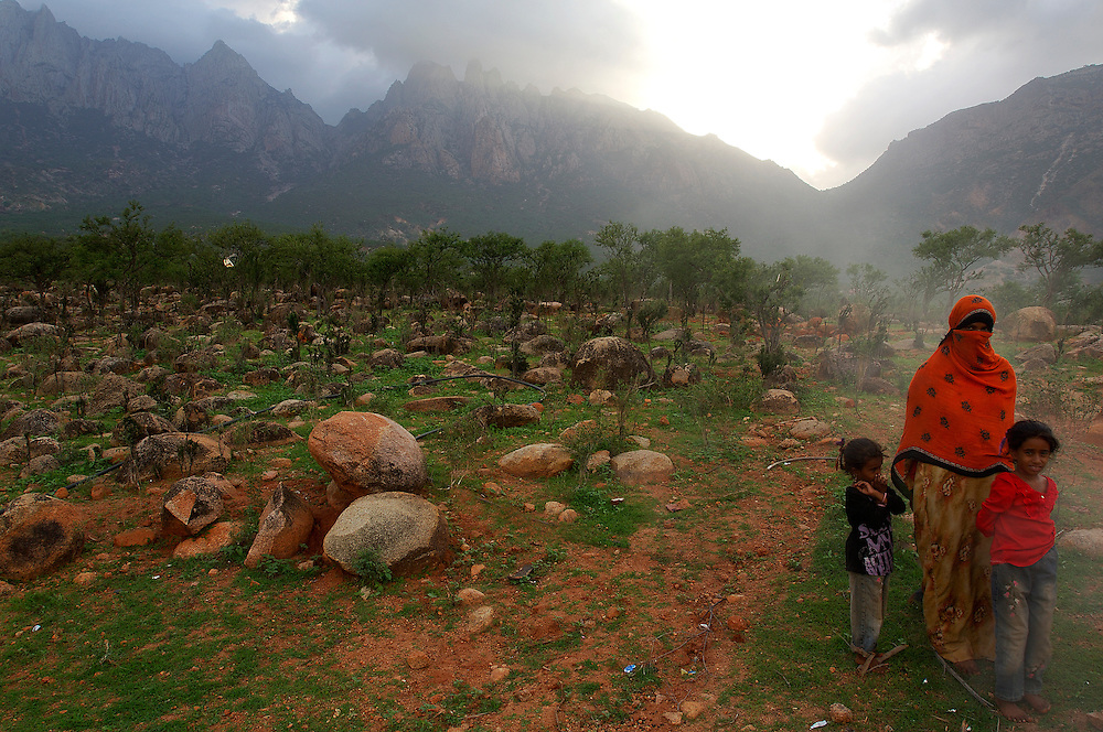 A local family at the outskirts of Hadido, Socotra island, Yemen. Dormant and indecisive, the island of Socotra has floated for millions of years between Africa and the Arabian peninsula. Such isolation makes it the ideal sanctuary for vegetation that has endured since the Tertiary period (65-2 million years ago), and a peaceful refuge for a vibrant aboriginal culture, an island shrouded in mystery and dark secrets.