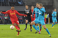 Thu., Feb. 14, 2013, Russia, St. Petersburg. .Liverpool's Raheem Sterling, left, against Zenit St. Petersburg's Alexander Anyukov, right, in the UEFA Europa League's last 32 match..Kommersant Photo/Alexander Petrosyan