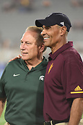 ASU Sun Devil Head Football coach Herm Edwards and MSU Head Basketball coach Tom Izzo pregame before the ASU MSU football game in Sun Daevil Stadium