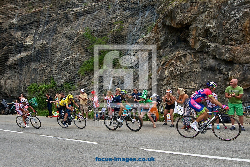 Picture by Ian Wadkins/Focus Images Ltd +44 7877 568959<br /> 18/07/2013<br /> Fans greet main group including race leader and yellow jersey holder Chris Froome begin the second ascent of Alpe d'Huez during stage 18 of the 2013 Tour de France in Bourg d'Oisans, France.