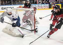 Antoine Roussel of France vs Jason Demers of Canada during the 2017 IIHF Men's World Championship group B Ice hockey match between National Teams of Canada and France, on May 11, 2017 in AccorHotels Arena in Paris, France. Photo by Vid Ponikvar / Sportida