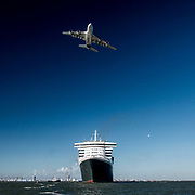 An Airbus A 380 flies over British cruise ship Queen Mary 2 taking the start of The Bridge 2017, a transatlantic race between the cruise liner RMS Queen Mary 2 and the world's fastest Ultim trimarans from Saint-Nazaire to New-York City on June 25, 2017 in Saint-Nazaire, France - Photo Vincent Curutchet / Dark Frame / ProSportsImages / DPPI