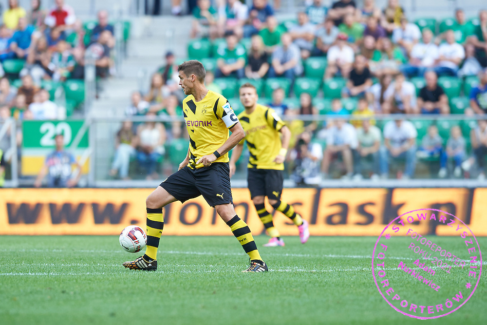 Sebastian Kehl of Dorussia Dortmund controls the ball during international friendly soccer match between WKS Slask Wroclaw and BVB Borussia Dortmund on Municipal Stadium in Wroclaw, Poland.<br /> <br /> Poland, Wroclaw, August 6, 2014<br /> <br /> Picture also available in RAW (NEF) or TIFF format on special request.<br /> <br /> For editorial use only. Any commercial or promotional use requires permission.<br /> <br /> Mandatory credit:<br /> Photo by &copy; Adam Nurkiewicz / Mediasport