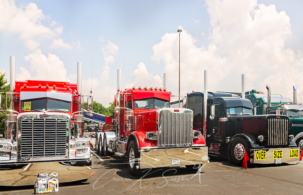 A trio of Peterbilts wait to be judged at the 34th annual Shell Rotella SuperRigs truck beauty contest, June 11, 2016, in Joplin, Missouri. SuperRigs, organized by Shell Oil Company, is an annual beauty contest for working trucks. Approximately 89 trucks entered this year's competition. (Photo by Carmen K. Sisson/Cloudybright)
