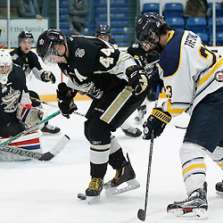 TRENTON, ON - NOV 10:  Nick Boddy #44 of the Trenton Golden Hawks keeps the puck from Adam Tretowicz #23 of the Buffalo Jr. Sabres during the OJHL regular season game between the  Buffalo Jr Sabres and Trenton Golden Hawks on November 10, 2016 in Trenton, Ontario. (Photo by Amy Deroche/OJHL Images)