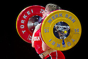 Marina Sisoeva from Uzbekistan lifts in Clean and Jerk competition women's 53 kg Group B during weightlifting IWF World Championships Wroclaw 2013 at Centennial Hall in Wroclaw on October 21, 2013.<br /> <br /> Poland, Wroclaw, October 21, 2013<br /> <br /> Picture also available in RAW (NEF) or TIFF format on special request.<br /> <br /> For editorial use only. Any commercial or promotional use requires permission.<br /> <br /> Mandatory credit:<br /> Photo by &copy; Adam Nurkiewicz / Mediasport