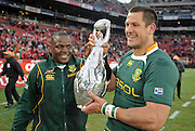 Pierre Spies and Chiliboy Ralepelle of the Springboks with the 2009 Lions Series Trophy.<br /> Rugby - 090704 - Springboks vs British&Irish Lions - Coca-Cola Park - Johannesburg - South Africa. The Lions won the third test 28-9 but lost the series 2-1 to the Springboks.<br /> Photographer : Anton de Villiers / SASPA