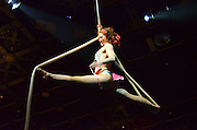 March 15, 2014-New York, NY-In the air, aerial performer Tina Cione twirled and went completely upside all while undressing herself. 3/15/14 Photo by Melanie Bencosme/NYCity Photo Wire