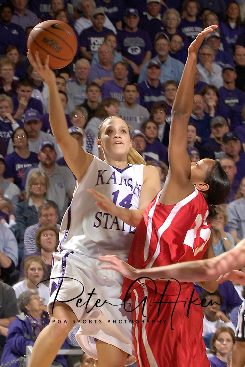 Kansas State guard Claire Coggins (14) puts up a shot over Western Kentucky's Dominique Duck (R), during the overtime period at Bramlage Coliseum in Manhattan, Kansas, March 28, 2006.  K-State defeated Western Kentucky 57-56 in overtime of the WNIT Semifinals.