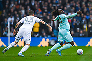 Leeds United midfielder Mateusz Klich (43) fouls Queens Park Rangers midfielder Eberechi Eze (10) during the EFL Sky Bet Championship match between Leeds United and Queens Park Rangers at Elland Road, Leeds, England on 2 November 2019.