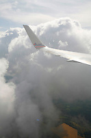 airplane wings, flying over and arriving into Paris Charles de Gaulle Airport