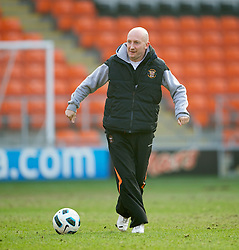 BLACKPOOL, ENGLAND - Wednesday, March 3, 2011: Blackpool's manager Ian Holloway shows off his ball skills on the pitch after his reserve side beat Liverpool 2-1 during the FA Premiership Reserves League (Northern Division) match at Bloomfield Road. (Photo by David Rawcliffe/Propaganda)