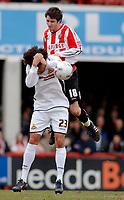 Photo: Daniel Hambury.<br />Brentford v Doncaster Rovers. Coca Cola League 1. 25/03/2006.<br />Brentford's Sam Tillen and Doncaster's Jason Price battle.