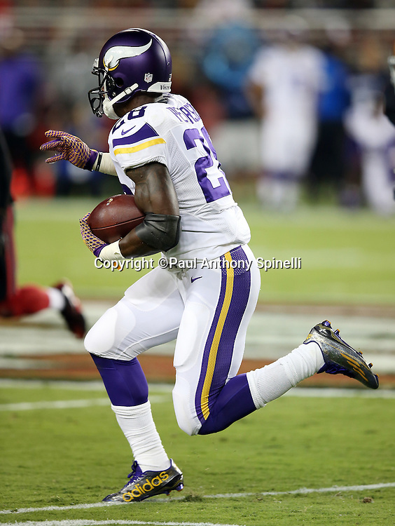 Minnesota Vikings running back Adrian Peterson (28) catches a pass in the flat and runs for a gain of 17 yards and a second quarter first down during the 2015 NFL week 1 regular season football game against the San Francisco 49ers on Monday, Sept. 14, 2015 in Santa Clara, Calif. The 49ers won the game 20-3. (©Paul Anthony Spinelli)