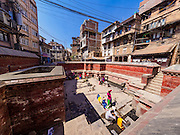 06 MARCH 2017 - KATHMANDU, NEPAL: A public well in Kathmandu, near Durbar Square. Homes in the area don't have adequate water supplies so people come to the well every day. The neighborhood is hundreds of years old and was built before domestic water distribution came to Nepal. The well has been the neighborhoods main water source for most of the time.      PHOTO BY JACK KURTZ