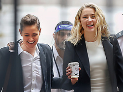 © Licensed to London News Pictures. 27/07/2020. London, UK. American actor AMBER HEARD arrives with Bianca Butti (L) at the High Court in London, where Johnny Depp is in a legal dispute with UK tabloid newspaper The Sun over allegations he assaulted his former wife, Amber Heard. Photo credit: Peter Macdiarmid/LNP