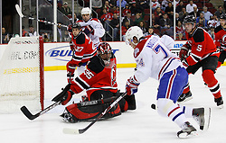 Jan 21, 2008; Newark, NJ, USA; Montreal Canadiens left wing Sergei Kostitsyn (74) skates with the puck by New Jersey Devils goalie Scott Clemmensen (35) during the first period at the Prudential Center.