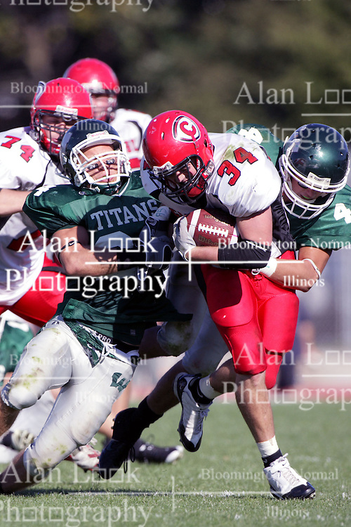 04 October 2008: Jake Smith breaks through the line and into the secondary while Robert Beauchamp and Nick Nikolich works to slow his run in a battle between the Carthage Red Men and the Illinois Wesleyan University Titans, .Game action was at Wilder Field on the campus of Illinois Wesleyan University in Bloomington Illinois.