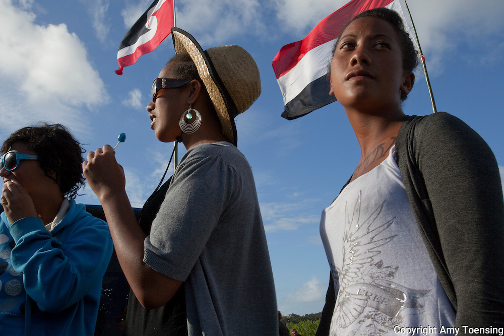 WAITANGI, NEW ZEALAND -- FEBRUARY 04: The annual gathering commemorating the signing of the Waitangi Treaty, February 6, 1840 in Waitangi. ..Girls:..Hana Cooper (straw Hat).Huria Martin (Blue shirt and sunglasses).Shyloh Cooper (Gray Shirt and writing on chest).Ruiha Cooper (youngest).Ngawiki Cooper (young boy w/ messy hair).Marara Cooper (striped sunglasses)..Maori TV news caster, Dean Nathan with his partner Mere Paul (Blue dress with white shawl)..dean.nathan@maoritelevision.com.+64 (0)21 381 985..Son: Tuwhenuaroa Natanahira..Girls with Maori Warden: Hazel Turner +64 (0)27 764 3754...Photo By Amy Toensing _________________________________<br />