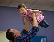 Ryan Jeffers plays with his daughter  Malyia Jeffers after physical therapy at the Shriner's Children Hospital in Sacramento...Malyia Jeffers is a toddler who lost parts of her limbs after a medical saga that began with a high fever on a Sunday morning.  It turned out that she was a victim of a severe Streptococcus A infection.  Malyia spent several months in the Stanford Children's Hospital ICU and Davis Medical Center where she underwent limb amputations and skin grafts among numerous other medical treatments.  Her father spends many hours with her as he struggles to keep the family going, and plan for a very different future. March 24, 2011.