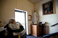 "CHAMPION, WI - DECEMBER 22:Debbie Banda, right, of Menasha Wis. is hugged by her mother Mary Young, left, of Bear Creek Wis. as she is overcome by the beauty of the statue of the Blessed Virgin Mary at the Shrine of Our Lady of Good Help in a small rural town in northern Wisconsin, December 22, 2010 in Champion, Wisconsin. After years of research, the Bishop of Green Bay determined that the sightings of Mary ""clothed in dazzling white"" are indeed ""worthy of belief"" and now have now been officially sanctioned as real by the Vatican. This shrine is the first of such for the United States and now joins the company of Lourdes and Fatima.   (Darren Hauck )"