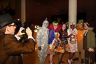 DAI marketing and communications manager Eric Brockman (left) takes a picture of a group attending the Wizard of Oz party at the Dayton Art Institute, Friday, April 12, 2013.