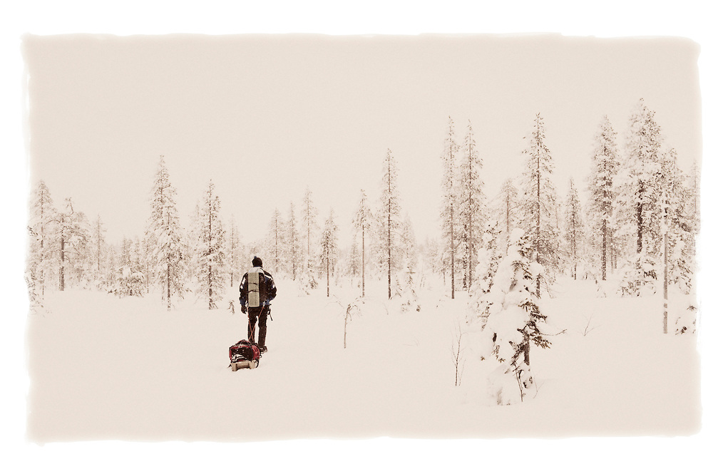 Man pulling a sledge, Riisitunturi National Park, Finland