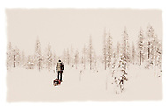 Man pulling a sledge, Riisitunturi National Park, Finland