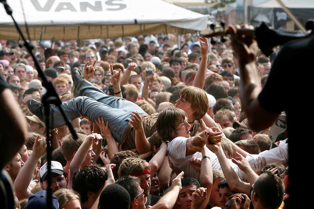 Spectators body surf to the tunes of Yellowcard  as they try to stay cool at the Van's Warped Tour stop at the Utah State Fair Park in Salt Lake Cityi, Utah Saturday July 7, 2007.  August Miller/ Deseret Morning News