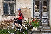 Cyclist in the village of Petrina along the Kupa River, Slovenia